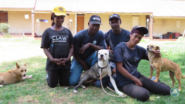 Maggie, a dog rescue by CLAW, takes a photo with CLAW staff at the Durban Deep office.