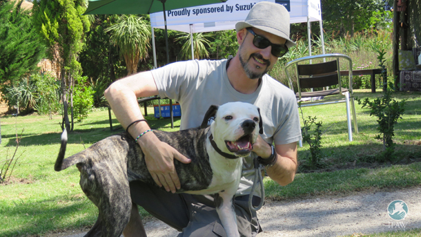 Rescued pup Maggie and her adoptive owner at CLAW's Meet  the Heroes event.