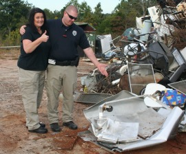 Alexander County Animal Shelter animal control officer Jennifer Pennell, and animal services supervisor Ben Whisenant, point at a destroyed gas chamber.