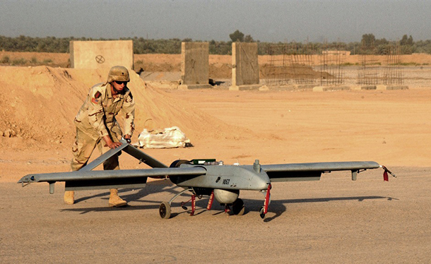 An operator launches a Shadow 200 UAV from a base in Afghanistan. Image source: Wikipedia