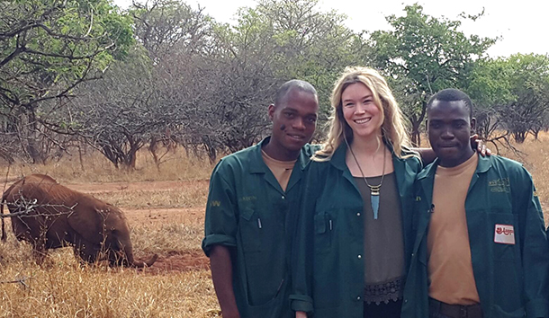 Joss Stone with Zambia Elephant Orphanage keepers Aaron Gumbo and Oliver Munyama, with orphan elephant Nkala in the background.