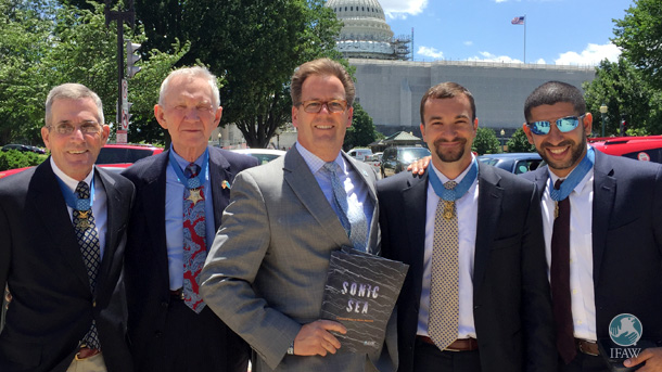 Following today's Congressional briefing, IFAW's Patrick Ramage, a third-generation serviceman, was honored to present four Medal of Honor recipients with copies of the new Sonic Sea report on ocean noise. Left to Right: Col. Gordon Roberts; Gen. James Livingston; IFAW's Patrick Ramage; SSgt. Sal Giunta; Cpt. Flo Groberg