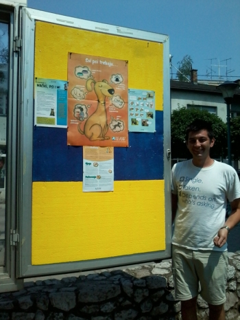 The author standing next to an educational poster posted in Gradacac.