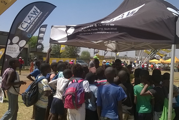 Children crowd the CLAW tent, where they signed a pledge not to get involved with dog fighting.