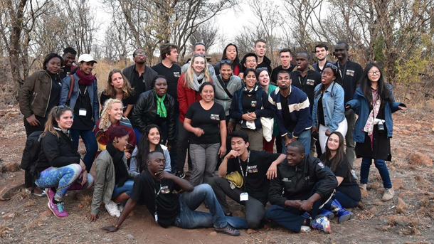 Youth Forum delegates pose together in Pilanesburg National Park