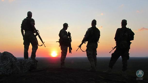 four rangers overlooking malawi sunset
