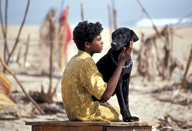 A boy named Emmanuel holding his dog¬¬ amid the debris from a devastating tsunami that hit fishing villages in Chennai, India in December 2014.