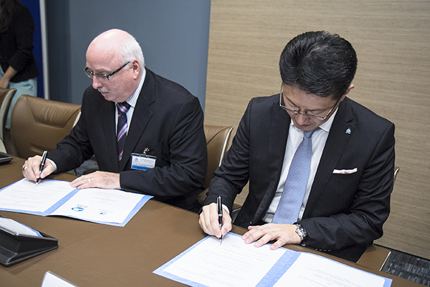The author signs an agreement with Noboru Nakatani, Executive Director of the INTERPOL Global Complex for Innovation (IGCI) to increase IFAW's already robust collaborations with INTERPOL.